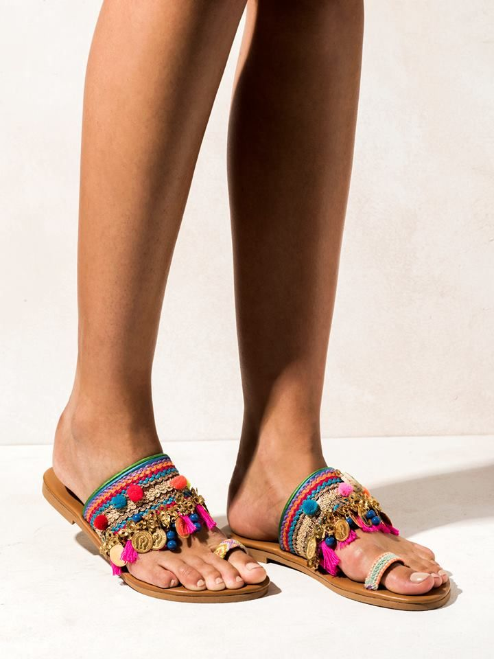 Jaipur  Cotton rainbow trim, mini pom poms, gold plated charms, semi-precious stones, hand-painted ceramic evil eyes and hot pink cotton tassels.  Get the experience: http://www.elinalinardaki.com/shoes/sandals/new-collection/sandal-jaipur/