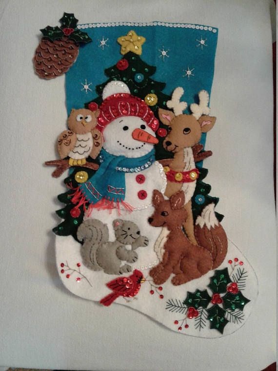 This is a Bucilla Handmade Christmas Stocking. Stocking includes hand stitching, beading, and sequins. 18 Long Free Personalization. Please indicate when ordering the following - NAME to be used COLOR of thread BLOCK or SCRIPT lettering Will ship completely assembled and ready to hang on