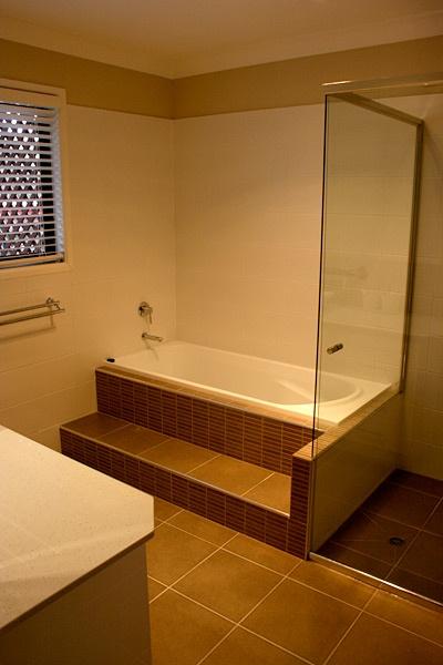 White Bath with Brown Bathroom Tiles - Bathroom Renovations Brisbane
