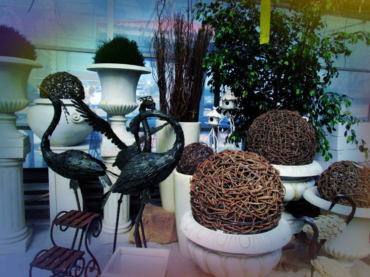 Tall free-standing birds, gorgeous white planters great for front porch