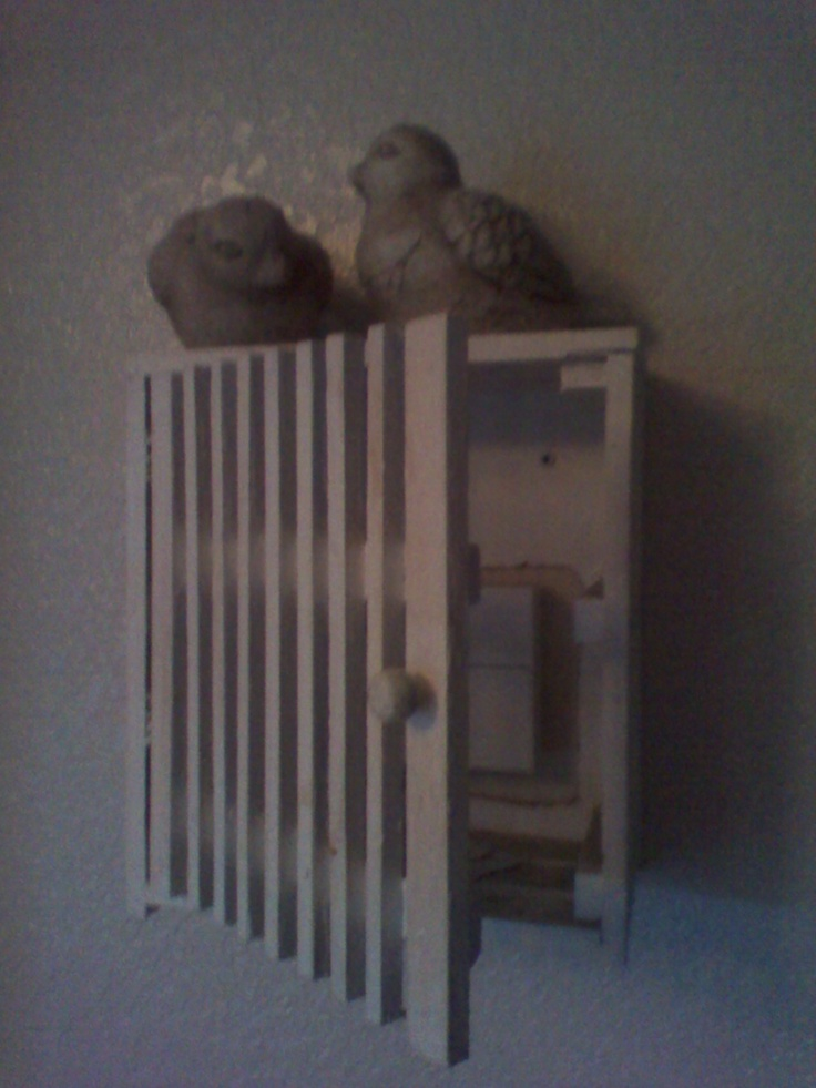 I've hidden my thermostat inside an old wooden box that I painted (cut a hole in the back).  The top serves as a shelf.