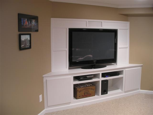 Would house flat screen or rear projection TV. Some storage space. Ledge in  middle - 8 Best Images About Corner Entertainment Center On Pinterest