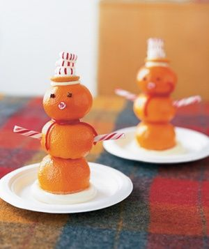 For a holiday party, give each child three oranges, some toothpicks, a sturdy plate, and store-bought frosting. Stick the large orange to the center of the plate with a dollop of frosting. Poke a few toothpicks halfway into the top of the fruit and spear a smaller orange on top. Repeat with the third orange, and layer on frosting, a vanilla wafer, and peppermints to make a hat. Use candy-cane pieces for arms and a nose, cloves for the eyes, and red licorice for a scarf. #RSHoliday