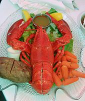 American lobster - Lobsters are usually cooked alive, which may be illegal in certain areas and which some people consider inhumane. Meat is generally contained in the larger claws and tails, and stays warm quite a while after being served. There is some meat in the legs and in the arms that connect the large claws to the body. There is also some small amount of meat just below the carapace around the thorax and in the smaller legs.