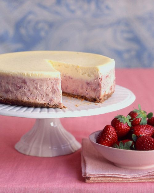Intense oven-roasted strawberries are folded into a blend of tangy mascarpone and cream cheese -- Strawberries-and-Cream Cheesecake Recipe