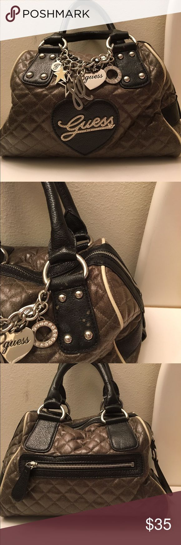 Bag Guess bag.... very nice colors. Has some wear and tear around the handle as shown in the picture, other than that it's in ok condition. Guess Bags Mini Bags