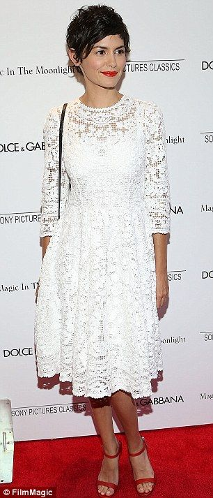 The white stuff: Audrey Tautou showed off her slim figure in a white lacy dress and red sh...