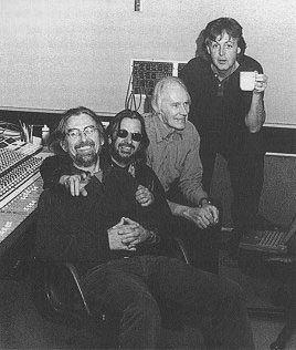 George Harrison, Ringo Starr, George Martin (The Beatles's producer), and Paul McCartney.