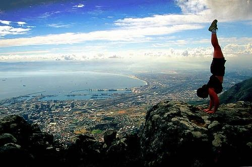 What will you do if we send you to the top of Table Mountain on the house? #handstand #wow #tablemountain #capetown #fun #adventure #discover #travel #tour #view #atlanticocean #daytrip #oceanview #beourguest