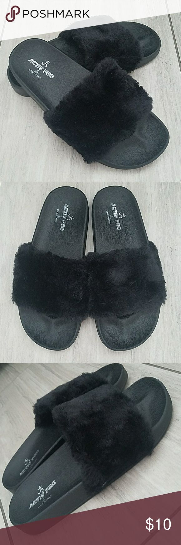 NWT black fur slides sandals. New furry black slides. Ordered online and they were a little to big for me. Super cute no damage. Tried on in the house so they havent even seen outside. Thick black bottom. Soft fur. No shedding. Dont forget to bundle and save. I also have a few listings in my closet that come free with a purchase. activ pro Shoes Sandals
