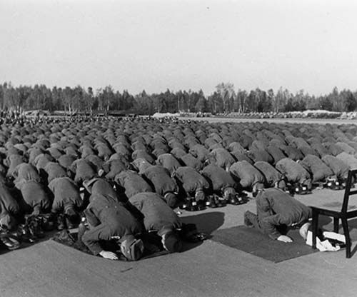 Muslim members of the Waffen-SS 13th division at prayer during their training in Germany, 1943 The photo is taken during the division training at Neuhammer. The romantic notions that Himmler had about the Bosnian Muslims were probably significant in the division's genesis.