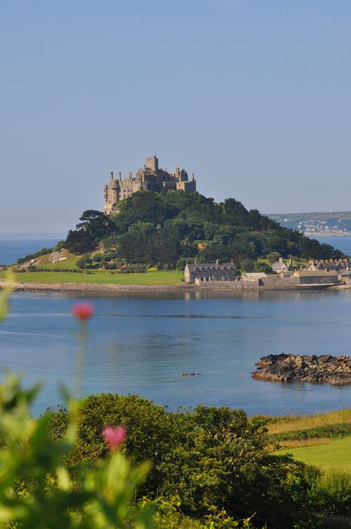 St. Michael's Mount, Cornwall, England by NDB123. I hope we can catch low tide so we can walk across!