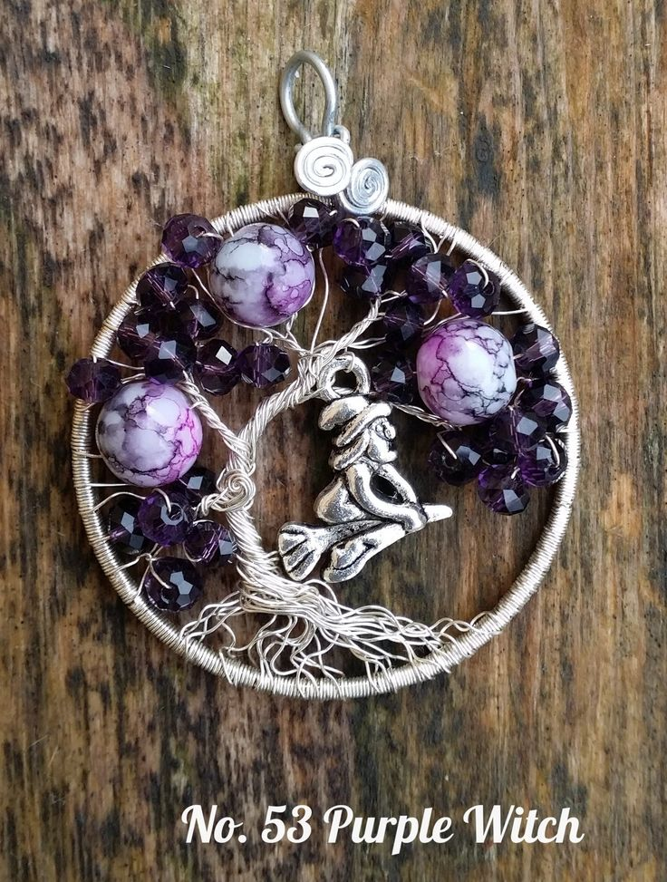Wire Tree Pendant. No.53 Silver plated wire with purple marmered , dark purple facet beads and zilver plated witch. hand made by Sabine Stroo - van de Flier.