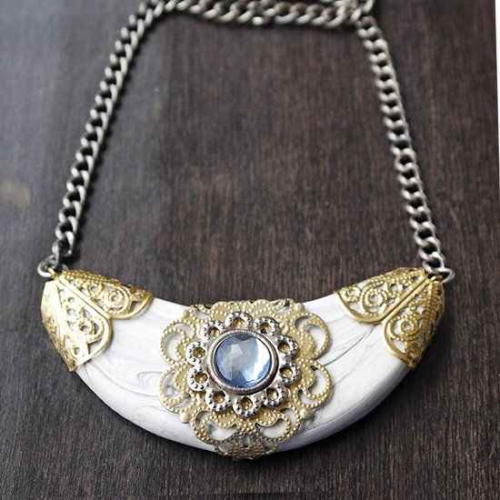 Learn how to make this necklace with polymer clay and scrapbook embellishments. Check out how!