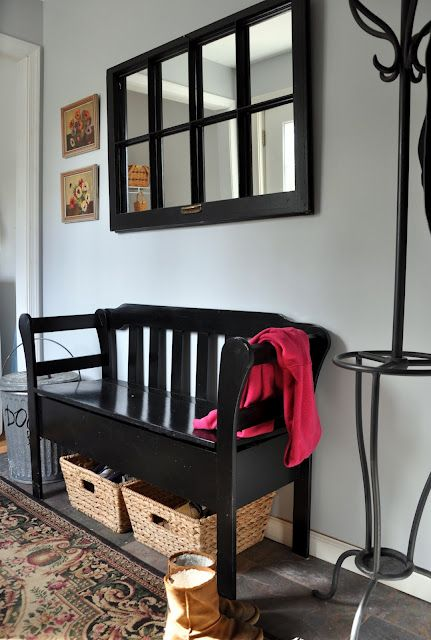 entry way/ foyer. Place to sit to put your shoes on and storage use to old french door with pictures in it for above the bench