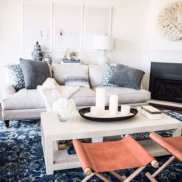 Living room inspiration courtesy of @arianalauren | Cooper Leather Stools, Blake Raffia Coffee Table & Kyoto Pillow Covers via Serena & Lily