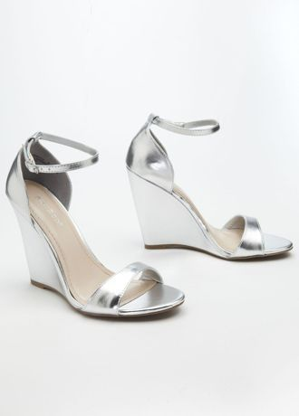 "Very trendy and comfy, these silver metallic wedge sandals are simply fabulous!  Metallic wedge sandal features an ankle strap for added comfort and support.  Heel height: 4"".  Imported."