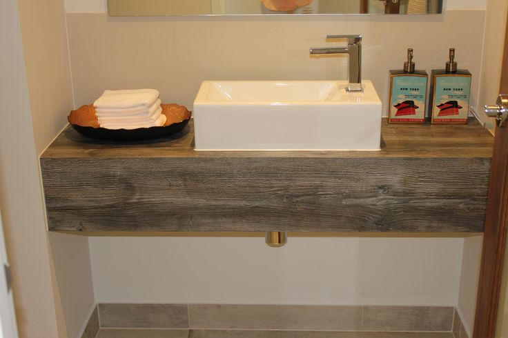 Egger Jackson pine laminate brings this small powder room to life with its diversity of colour