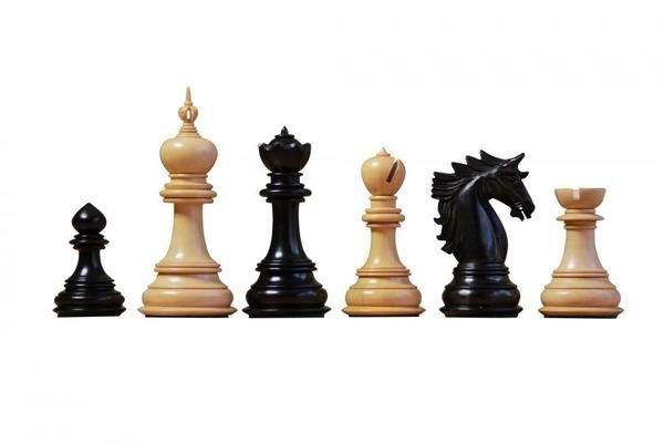 A strikingly detailed hand carved chess set featuring the Dubliner knight series. Hand carved ebony and boxwood chess pieces