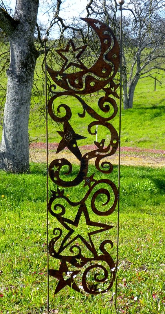 Garden trellis - I am going to have to take the welding class at the college in order to learn to use a plasma cutter.  Decorative even without plants climbing it!