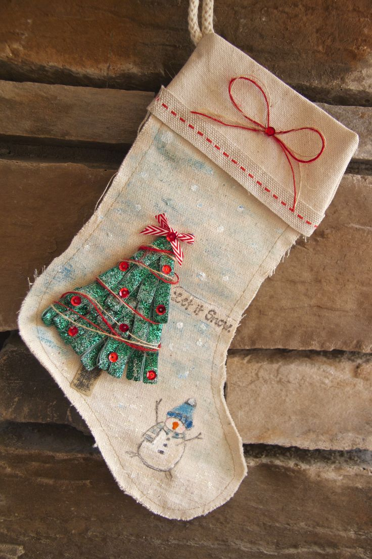 A handmade Canvas Christmas Stocking created by DT Lee-Anne Thornton made as a gift for someone.