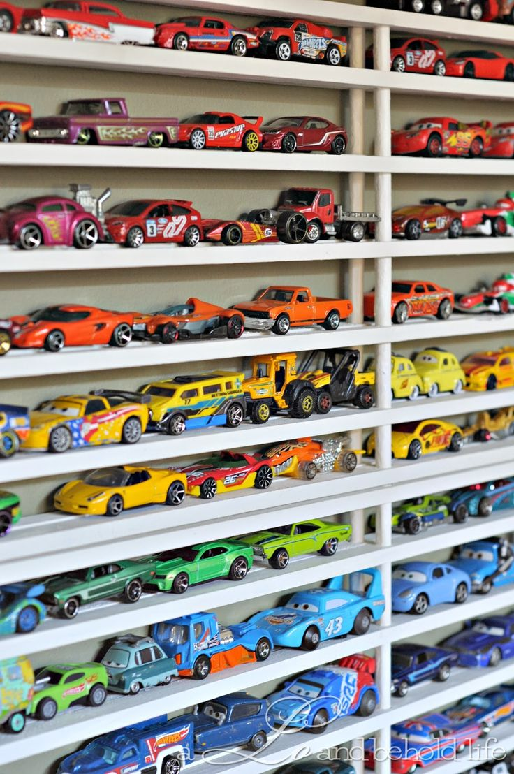 diy toy car display/storage from cheap shoe racks.  So fun for boys who love cars!: