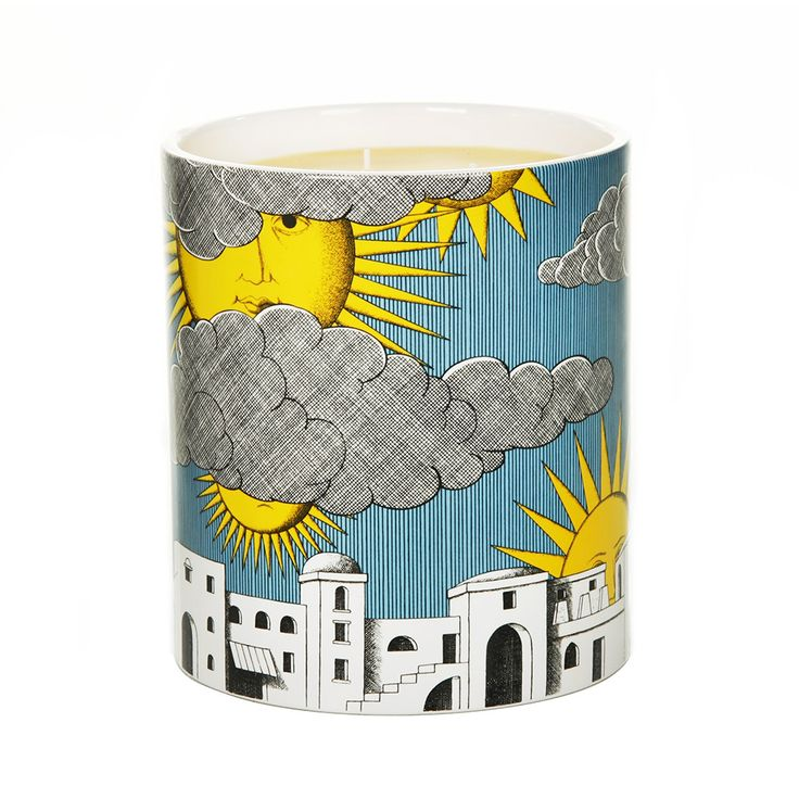 Transport yourself to a Mediterranean paradise with this Sole di Capri candle from #Fornasetti. Encased in a ceramic vessel featuring the Sole di Capri design of suns and clouds floating blissfully in a blue sky over the island's buildings, this candle has delicate fragrance notes of lemon, mandarin, bergamot, pine sap, galbanum and samphire.