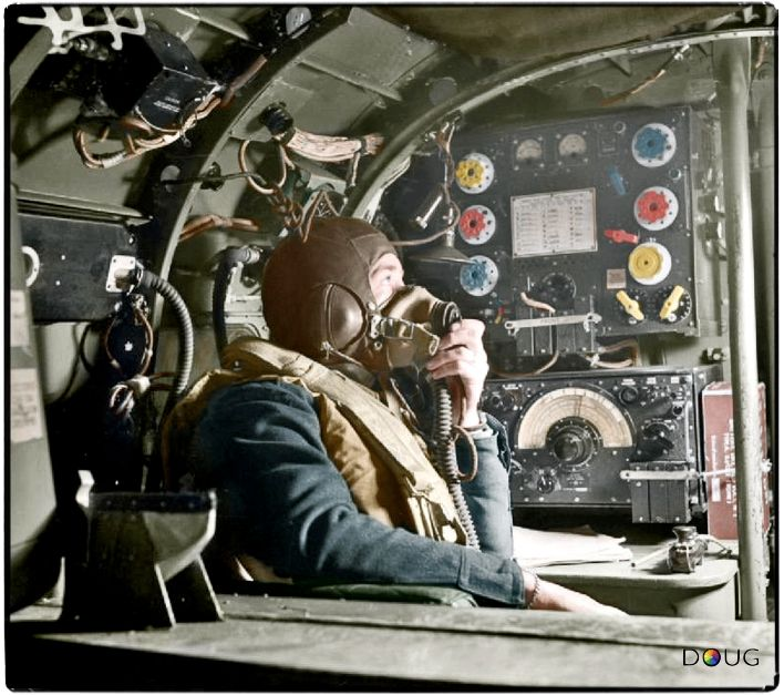Flying Officer R W Stewart, a wireless operator on board an Avro Lancaster B Mark I of No. 57 Squadron RAF based at Scampton, Lincolnshire, speaking to the pilot from his position in front of the Marconi TR 1154/55 transmitter/receiver set. 1942-43 (IWM CH8790)