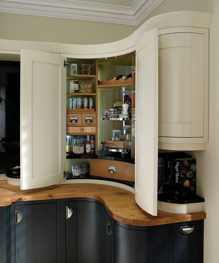 This beautiful curved corner pantry mixes old and new with the modern carousel central to the unit and classic touches of spice drawers, scalloped wine rack and granite shelves. kitchen storage