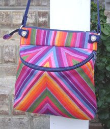 This Tandem Tote would be a great accent piece for your wardrobe.  :)