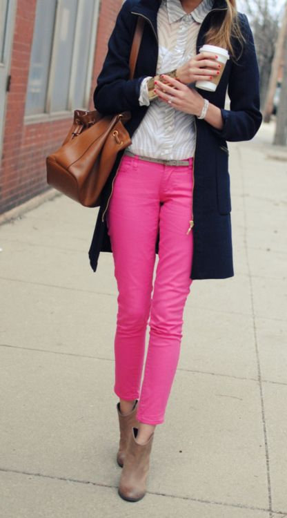 Modern preppy. Bright pink pants, white blouse, dark coat, leather bag, and tan ankle boots.  Love it.