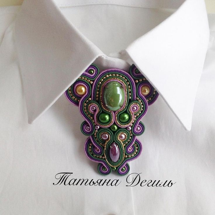 Purple, green and gold brooch
