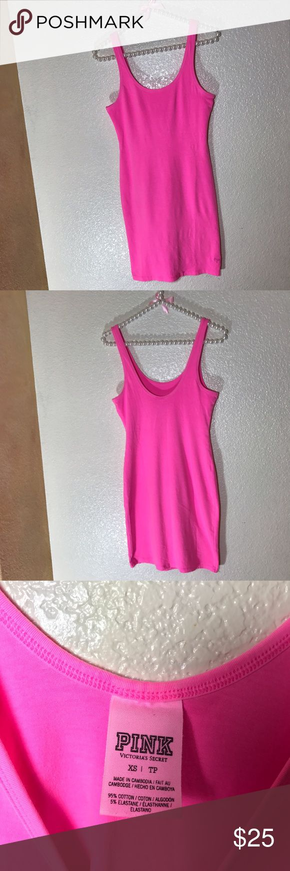 PINK Victoria's Secret Body Con Dress! Sz XS PINK Victoria's Secret Body Con Dress! Sz XS •GUC.     • Fluorescent/hot pink color • missing a few tiny stitches at the bottom in the front • see pic • hardly noticeable • soft and stretchy material • embroidered pink dog logo in the front lower corner PINK Victoria's Secret Dresses Mini