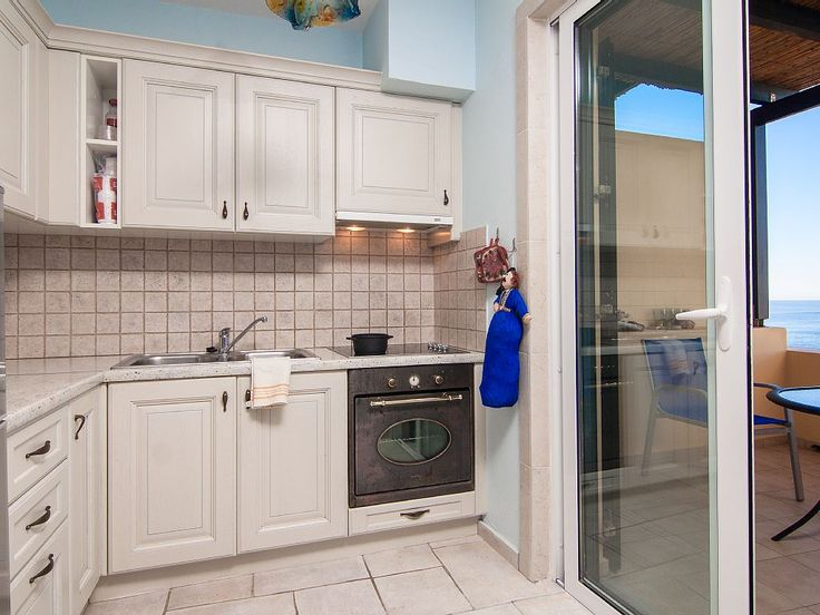 Panormos apartment rental - The fully equipped kitchen leads to a balcony, with a great sea view!