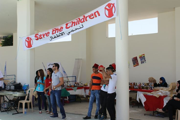 People start to gather at an event to mark World Refugee Day in the Bekaa, Lebanon, organised by Save the Children.