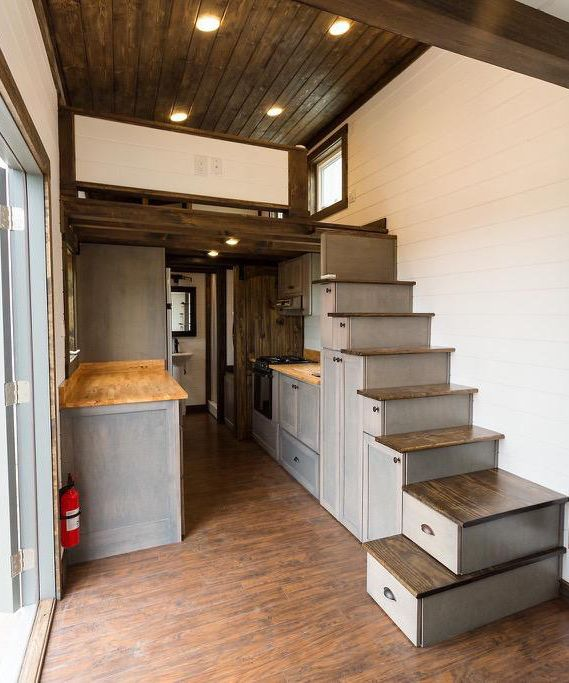 There is an extra hanging closet space in the storage stairs, double tray gun cabinet with lock, and they used a gym floor finish for extra durability.