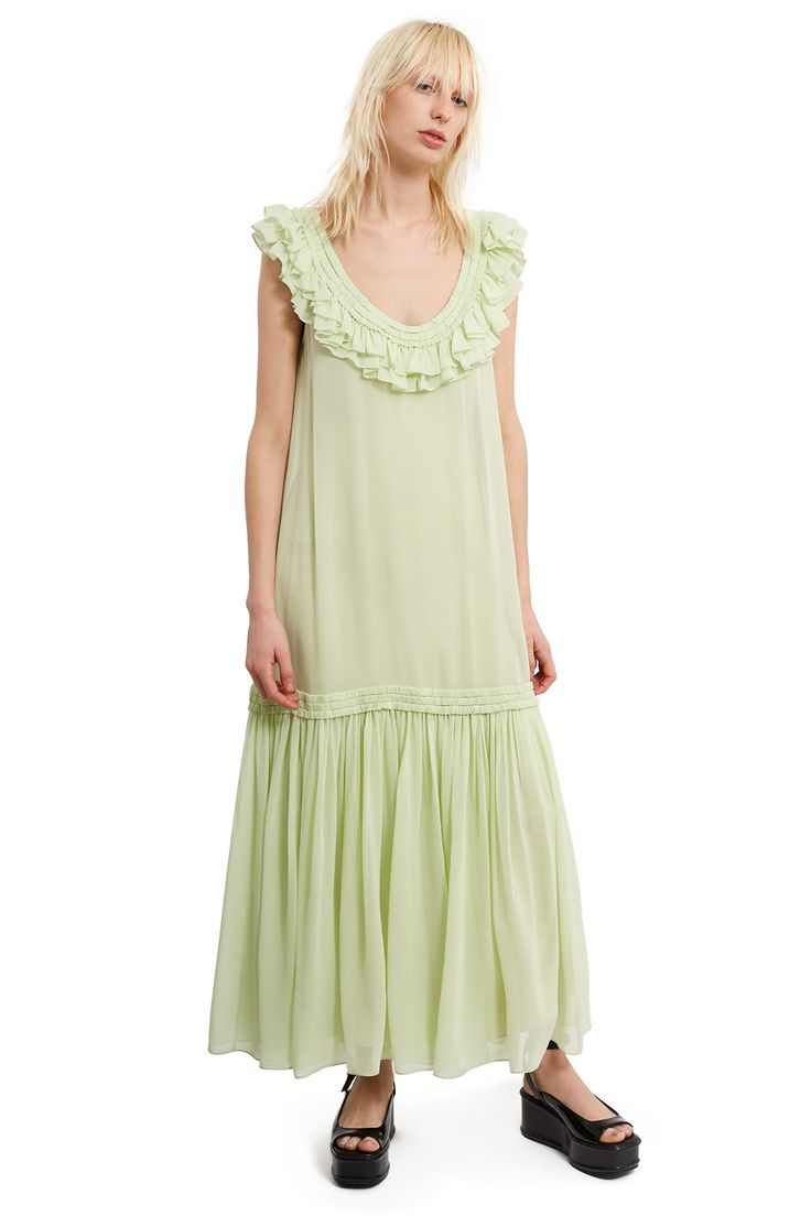 Opening Ceremony, Chiffon Ruffle Maxi Dress This maxi dress is crafted from sheer silk chiffon with an elegant scoop neck accented with layers of delicate feminine ruffles. A gathered dropped skirt panel creates subtle pleating, adding movement and volume to this breezy style., Shop all dresses here, Scoop neck, Includes tonal slip lining, Floor-length, 100% silk; lining: 100% polyester, Imported