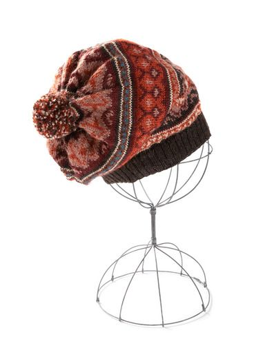 3e963f92d5a The hat is knit in bands of Peruvian geometrics in rose