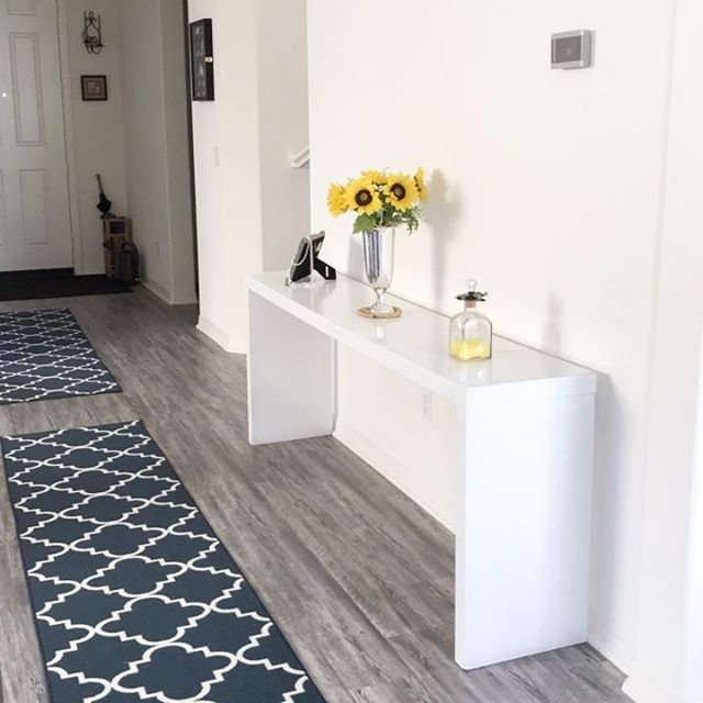 Repainted table thanks to my Mr. Charmed ❤️. Next, I would need some wall decors and some baskets below the table. Any suggestions?  . . . . . . . #interiordesign #interiordecor #interiordecorating #interiordesignideas #interiordecorator #wayfair #rugrunner #grayfloors #entrytable #entryway #entrywaydecor #entrywaytable