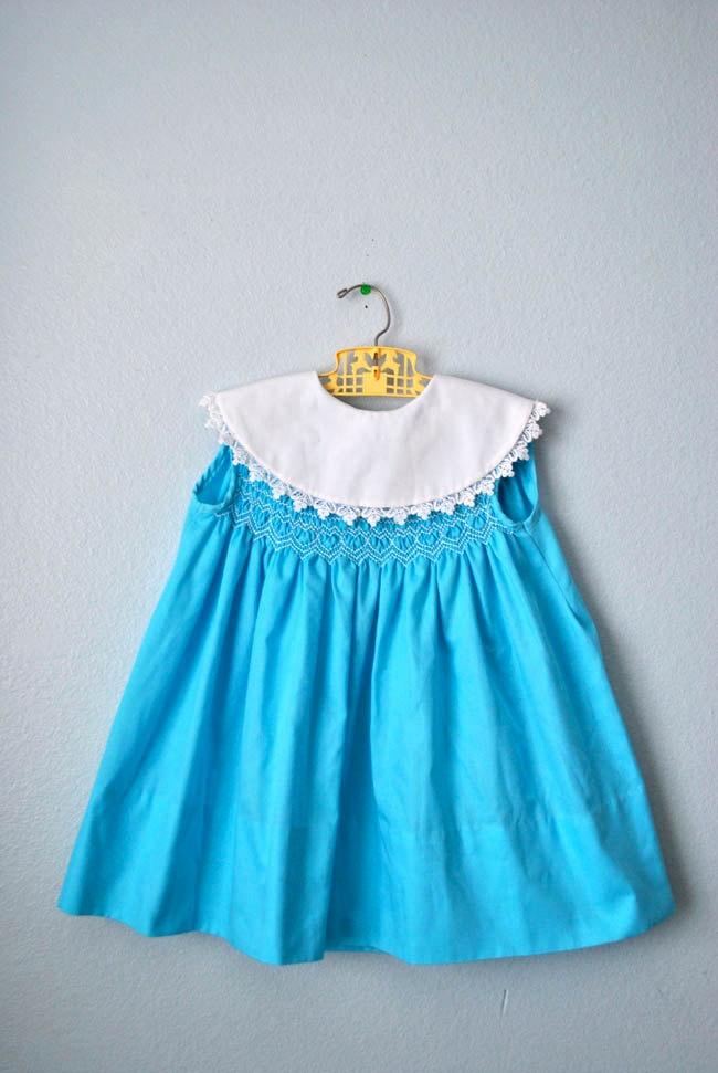 vintage girl aqua hand smocked dress