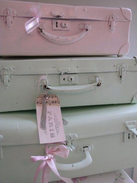 Pink painted vintage suitcases |