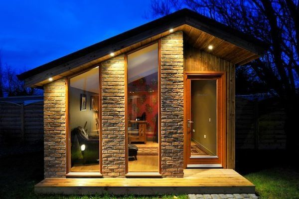 Making a Tiny/Small home doesn't mean it needs to look crappy. Quite the contrary - the smaller house means you can make better use of your budget. I love the (faux?) rock exterior detailing on this house.