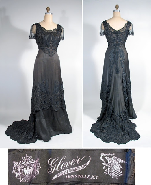Circa 1909-1910 Black Silk Crepe de Chine Evening Dress with Chinese embroidery, scalloped over skirt and net sleeves, by Madame Glover.