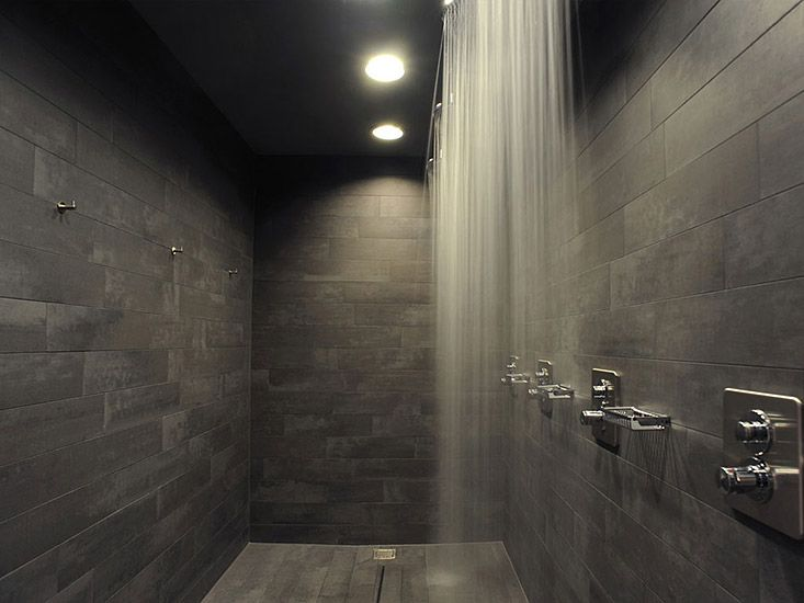 Modern dark shower tile with a curtain of water. Available at ...