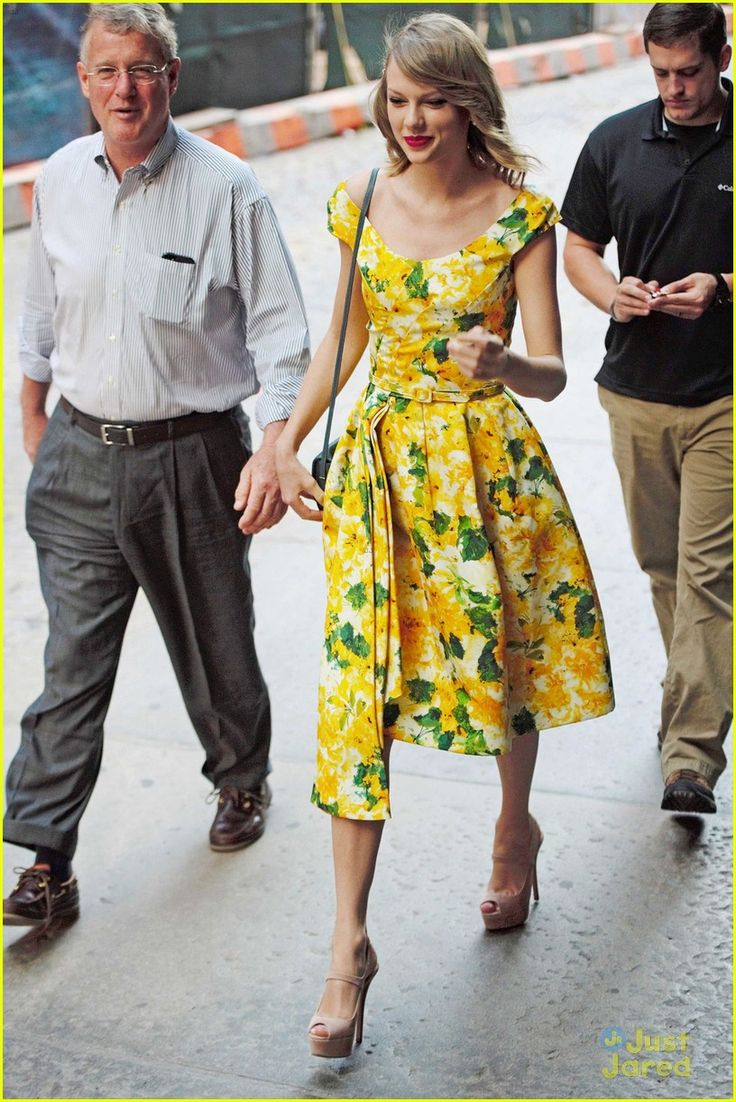 Taylor celebrating Father's Day with her dad in New York City on June 15, 2014 wearing an Oscar de la Renta dress and Prada sandals.
