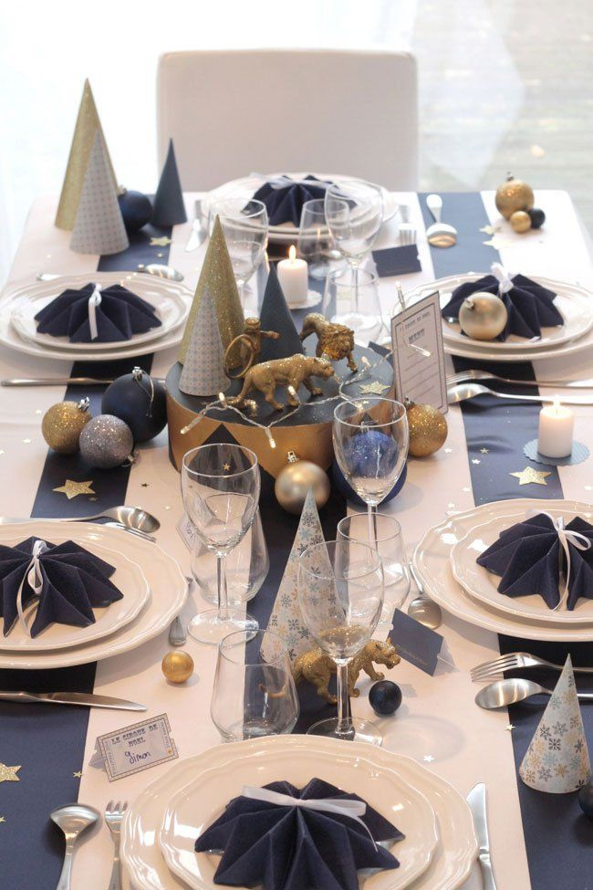 Dark blue with gold and white color combination for stylsh Christmas table