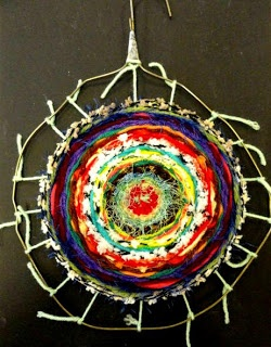 Weaving with a metal coat hanger! Good use for scraps of yarn and ribbon :)