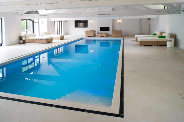 Minoli Tiles - Seastone - Amazing swimming pool, all around and pool internals tiled with #Minoli Seastone White with special pieces for the step treads and with a black border Seastone Black cut to size. Pool Internals: Seastone White 75 x 75 cm/ Pool Surrond: Seastone White 60 x 60 cm with Seastone Gradio (special pieces) for the surround step treads and with Seastone Black (cut to size) for the black border. - https://www.minoli.co.uk/tiles/seastone-white/