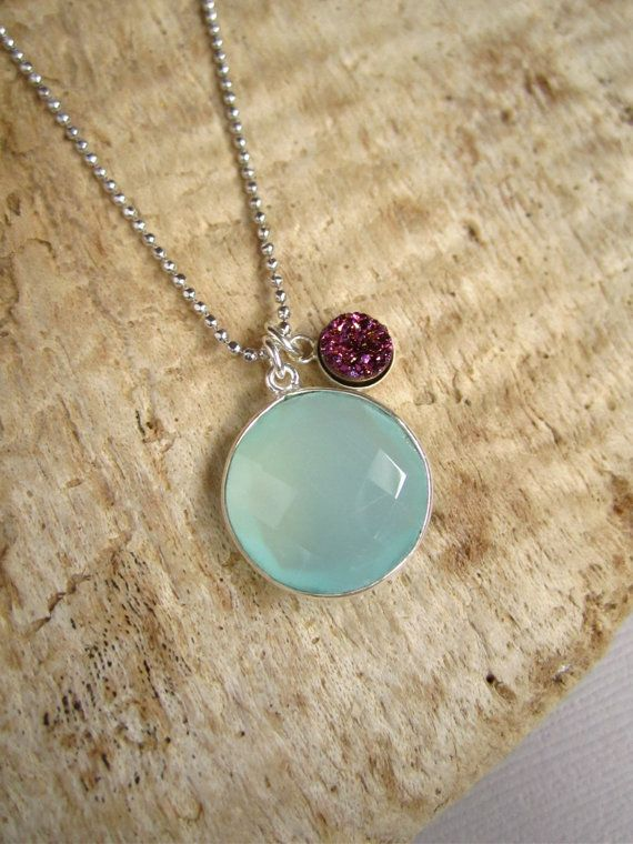 Glittering, titanium druzy rests freely beside a beautiful sea green chalcedony gem. Choose from either sterling silver or 14K gold fill necklace in 16 or 18. This color combination is gorgeous! Faceted, bezel set sea green chalcedony gem measures 16mm in diameter. Accompanying plum