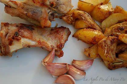 Coniglio all'aglio rosso di nubia con patate marinate arrosto